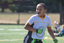 Youth athlete wearing a mouthguard